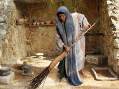 picture of woman sweeping floor looking for coin