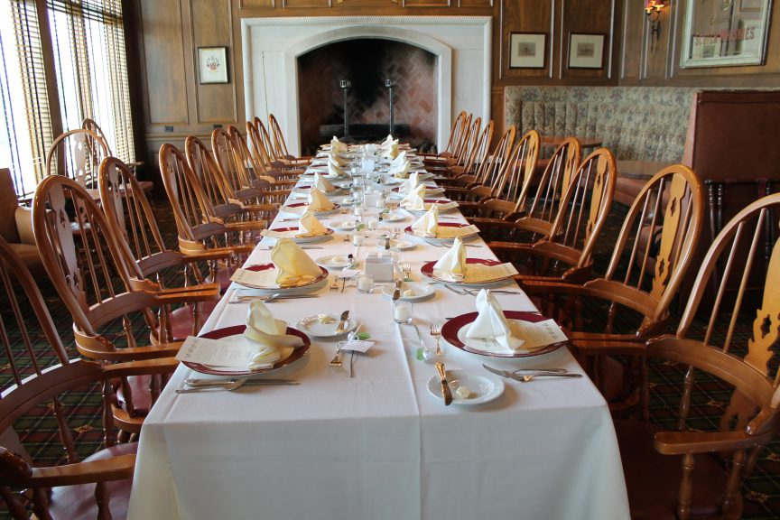 long dining table laid for a meal
